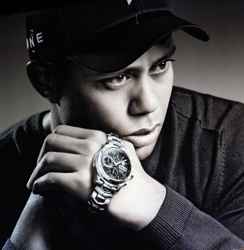 Tiger Woods s hodinkami TAG Heuer Link Calibre 16 Day/date